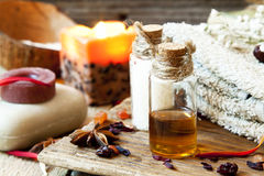 essential-oils-aromatherapy-spa-setting-bottles-soap-towel-anise-39310285